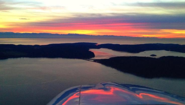 """Nine Minutes After Sundown."" Photo from 1,500' over Decatur Island, looking to the Southwest, Lopez Island, and the Olympic Peninsula. Photo by Jeffery A. Lustick"